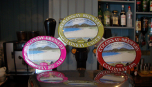 Taps of Colonsay Brewery beer at the Colonsay Hotel